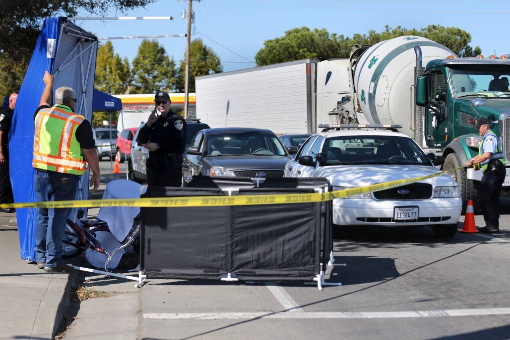 Petaluma police work at the scene of a fatal adult tricycle accident on Lakeville St. in front of In-N-Out Burger in Petaluma on Wednesday, October 23, 2019. (BETH SCHLANKER/ The Press Democrat)