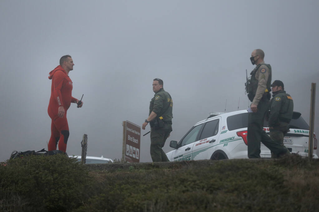 Fire and law enforcement personnel conduct a search and recovery operation for two children at Blind Beach south of Jenner, California, on Sunday, January 3, 2021. (Beth Schlanker/The Press Democrat)