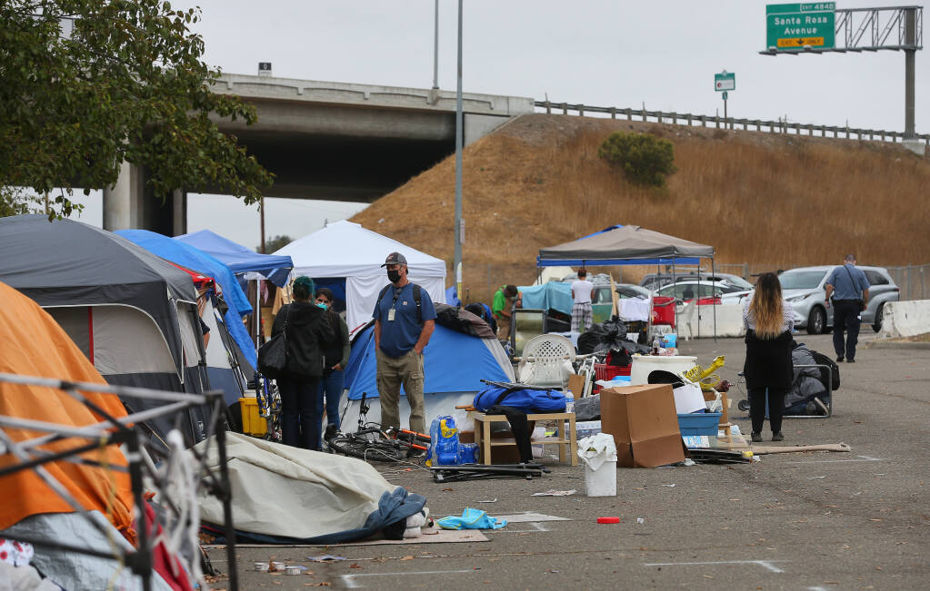 City of Rohnert Park personnel work on clearing out a homeless encampment at the Roberts Lake Park and Ride lot in Rohnert Park on Friday, September 10, 2021.  (Christopher Chung/ The Press Democrat)