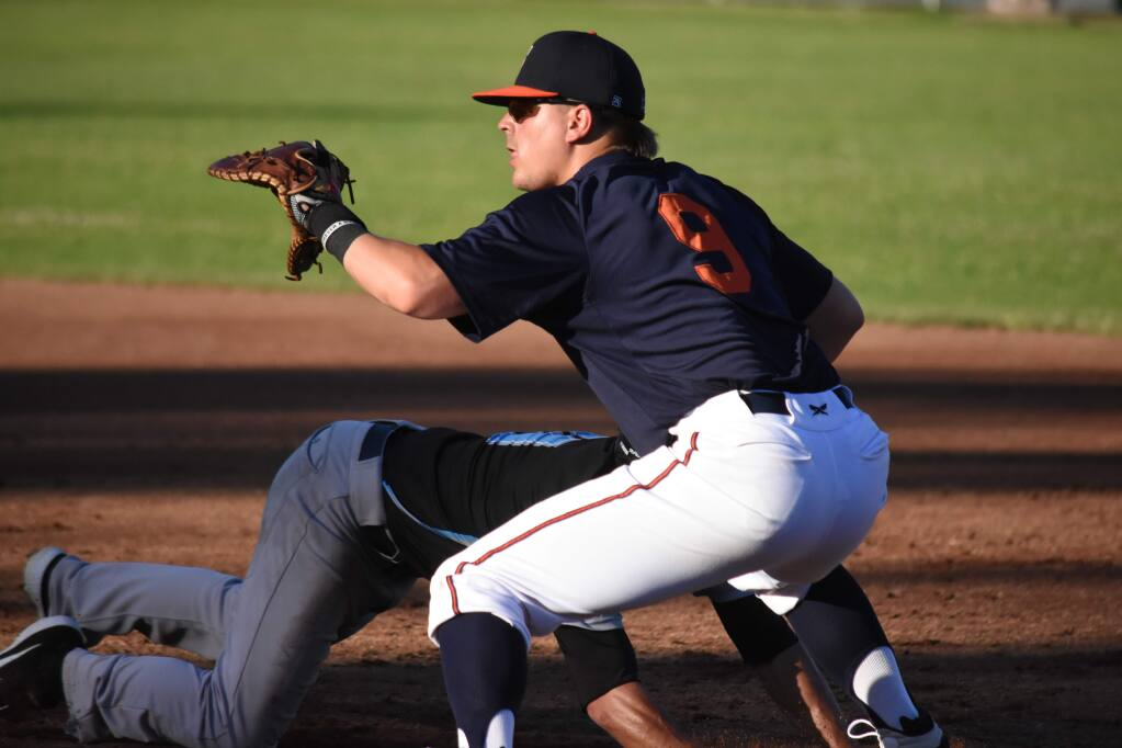 Chris Kwitzer (9) holds a Vallejo runner on during play at Arnold Field on Wednesday, June 5. Kwitzer played with the Pittsburg Diamonds last year, hitting .326. (James W. Toy III / Sonoma Stompers)
