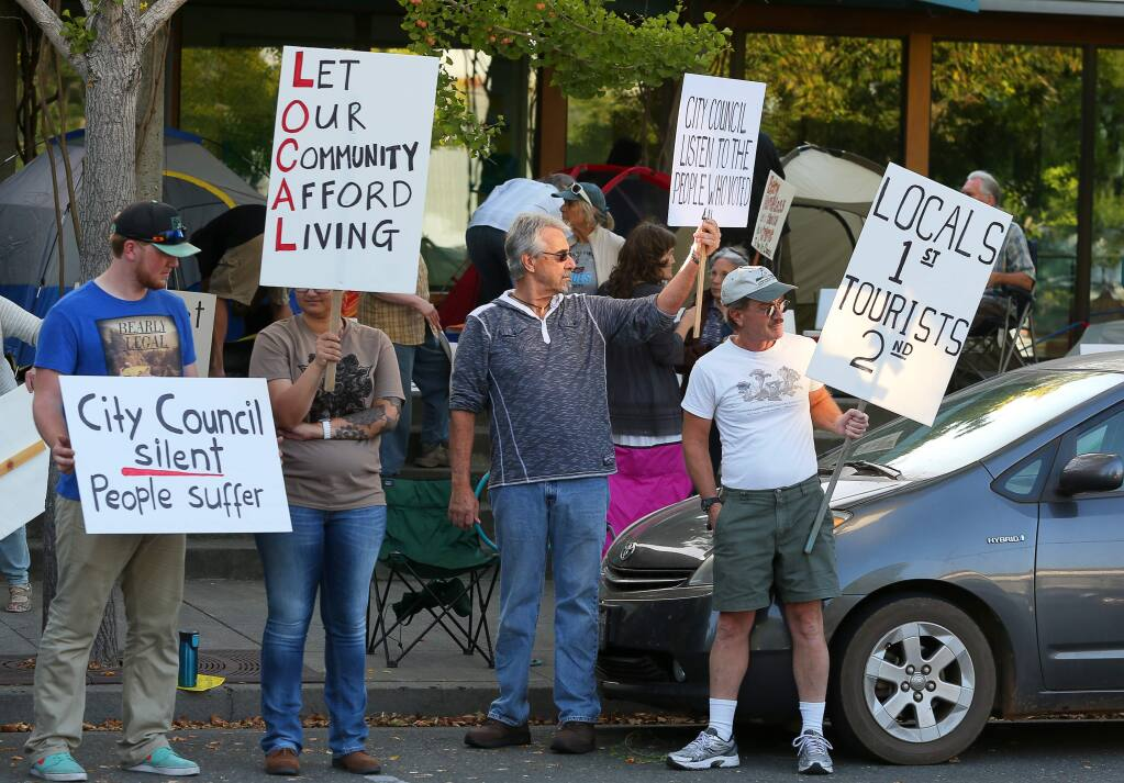 Protesters picket in favor of affordable housing in front of Healdsburg City Hall, where they pitched tents around the entrance, in Healdsburg on Monday, October 5, 2015. (Christopher Chung/ The Press Democrat)