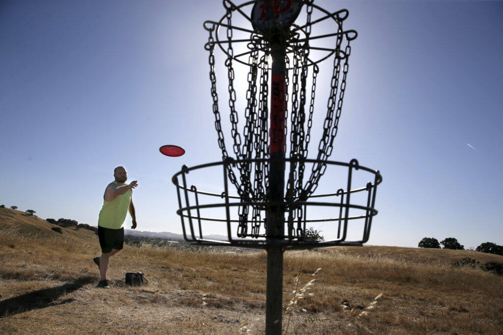 Scott Tanner plays disc golf at Crane Creek Regional Park in June 2018. Sonoma County Regional Parks is offering lessons for beginners interested in learning how to play. (Beth Schlanker / The Press Democrat)
