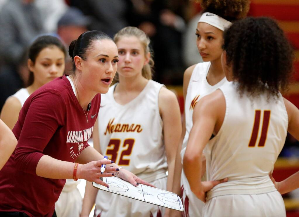 Cardinal Newman head coach Monica Mertle talks to her players during a timeout in the second half of the NCS Open Division playoff game against Heritage High School in Santa Rosa on Thursday, Feb. 20, 2020. (Alvin Jornada / The Press Democrat)