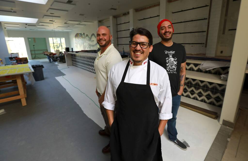 From left, co-owners Amos Flint, Jose Navarro and bar manager Danny Ojinaga are nearly ready to open their new restaurant Vertice on Courthouse Square in Santa Rosa. (John Burgess/The Press Democrat)