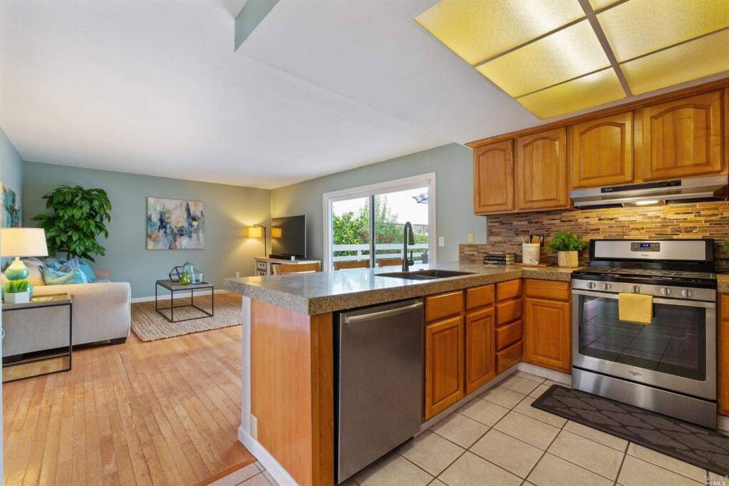 Keep your eye on the kids while preparing dinner in the open floor plan living space. Property listed by Danielle La Noire/ Compass, compass.com, 415-717-6942. (Courtesy of BAREIS MLS)