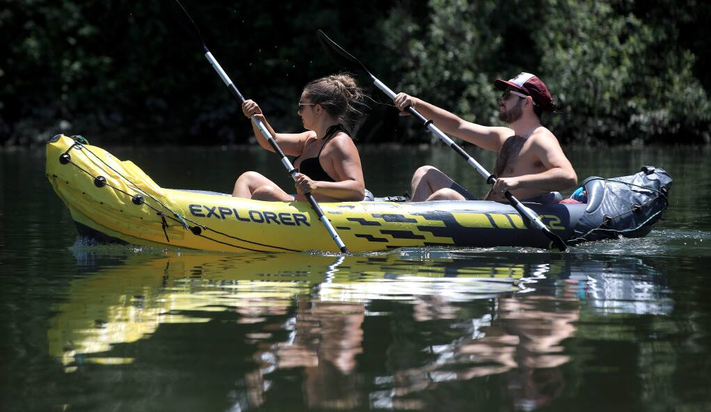 Placid conditions in the Russian River affords an easy paddle upstream near Monte Rio, Thursday, May 23, 2020. (Kent Porter / The Press Democrat) 2020