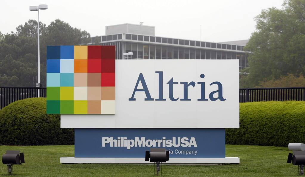 FILE - This April 23, 2008, file photo, shows the Altria Group Inc. corporate headquarters in Richmond, Va. The potential entry of one of the world's largest tobacco companies into the marijuana business is sending the shares of Cronos group rocketing this morning. Cronos is a Canadian cannabis company, which confirmed late Monday, Dec. 3, 2018, that it is in talks with Altria group about a possible investment. (AP Photo/Steve Helber, File)