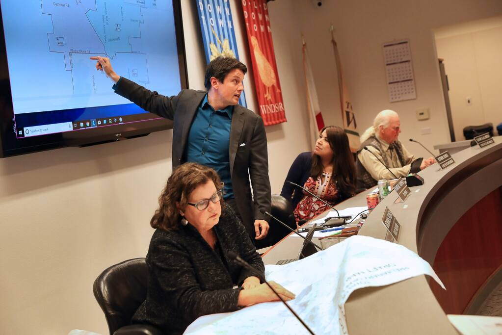 Windsor Town Council members Debora Fudge, left, Dominic Foppoli, Esther Lemus, and Sam Salmon consider the best way to draw a district voting map during a special meeting in Windsor on Monday, February 25, 2019. (Christopher Chung/ The Press Democrat)