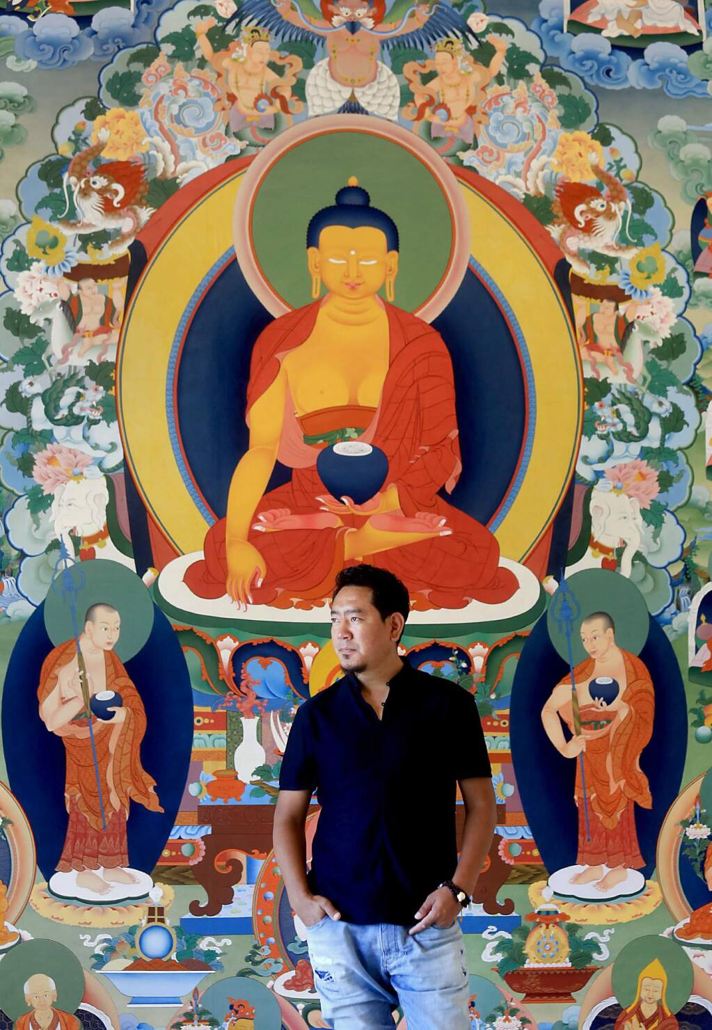 Tibetan master artist Tashi Dhargyal with a traditional Buddhist mural, a thangka. During the past four years Dhargyal has been working on the mural in his studio at the Barlow in Sebastopol. (Kent Porter / Press Democrat) 2017