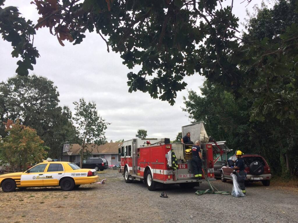 Fire crews respond to a house fire on Chico Avenue in Santa Rosa on Monday, Aug. 25, 2014. (PD STAFF)