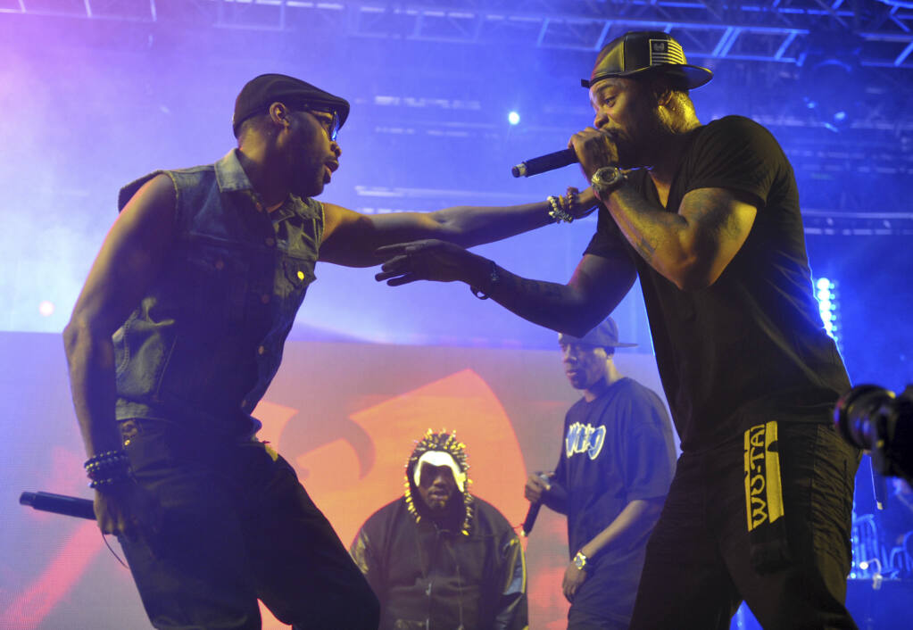 FILE - This April 21, 2013, file photo shows Robert Fitzgerald Diggs, aka RZA, left, and Clifford Smith, aka Method Man, of Wu-Tang Clan, right, performing at the second weekend of the 2013 Coachella Valley Music and Arts Festival in Indio, Calif. An unreleased Wu-Tang Clan album forfeited by Martin Shkreli after his securities fraud conviction was sold Tuesday, July 27, 2021, for an undisclosed sum, though prosecutors say it was enough to fully satisfy the rest of what he owed on a $7.4 million forfeiture order he faced after his 2018 sentencing. (Photo by John Shearer/Invision/AP, File)