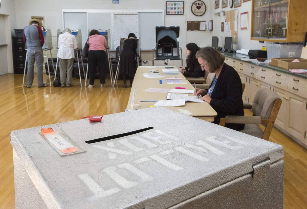 Voting at the Glen Ellen fire department on Tuesday, Nov. 6, in 2019. A proposed state constitutional amendment would allow 17-year-olds to vote in primaries, if they'll turn 18 by the time of the general election. (Photo by Robbi Pengelly/Index-Tribune)