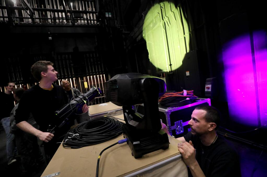 Lighting instructor Vince Mothersbaugh, right, trains theater students, including Kyle Sheridan, how to use a moving spotlight at the newly renovated Burbank Auditorium on the Santa Rosa Junior College campus in Santa Rosa on Friday, February 21, 2020. (BETH SCHLANKER/ The Press Democrat)