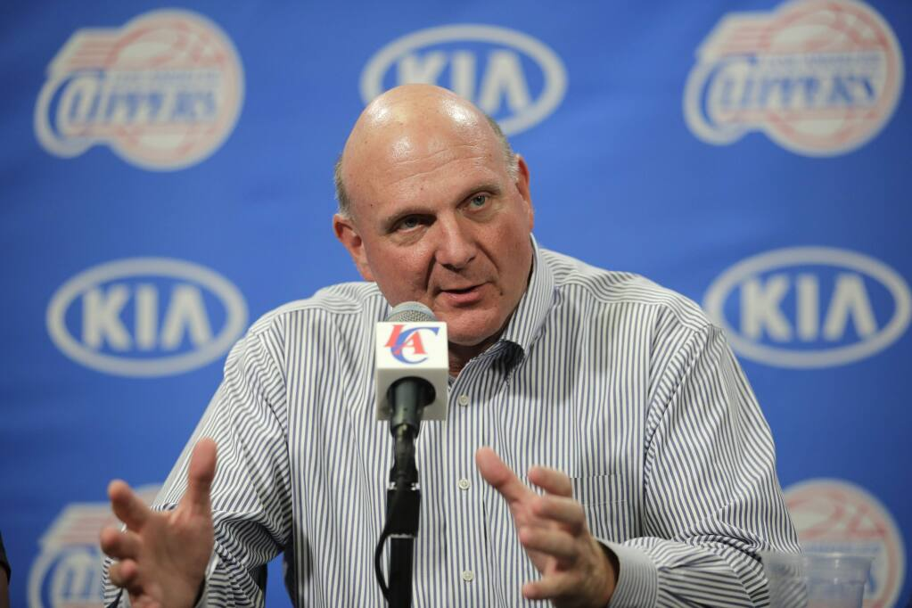 FILE - In this Aug. 18, 2014 file photo, new Los Angeles Clippers owner Steve Ballmer speaks during a news conference held after the Clippers Fan Festival in Los Angeles. Ballmer is stepping down from Microsoftís board, bringing to a close 34 years with the software giant. He says he plans to devote more time to his ownership of the Clippers, civic contributions, teaching and study. (AP Photo/Jae C. Hong, File)