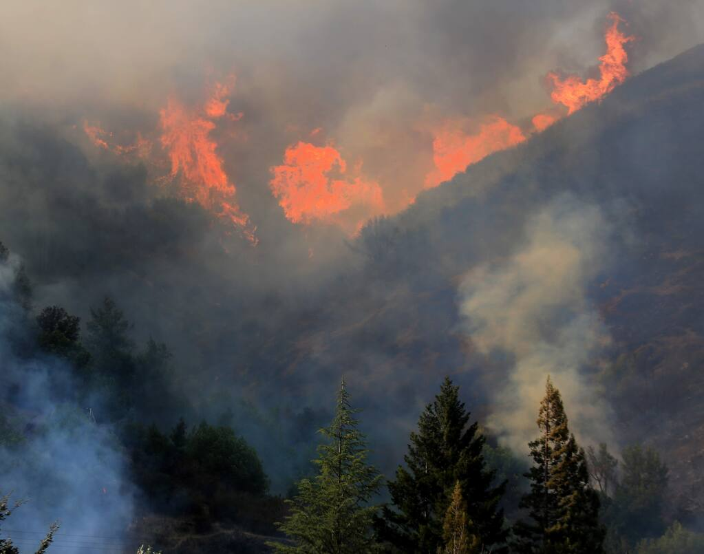 Flames rip up a hillside off Highway 20 in Lake County just east of Blue Lakes on Wednesday, Sept. 3, 2014. (KENT PORTER/ PD)