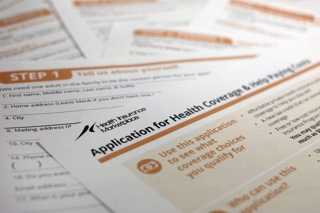 This Sept. 11, 2013, photo shows the federal government form for applying for health coverage. (AP Photo/J. David Ake)