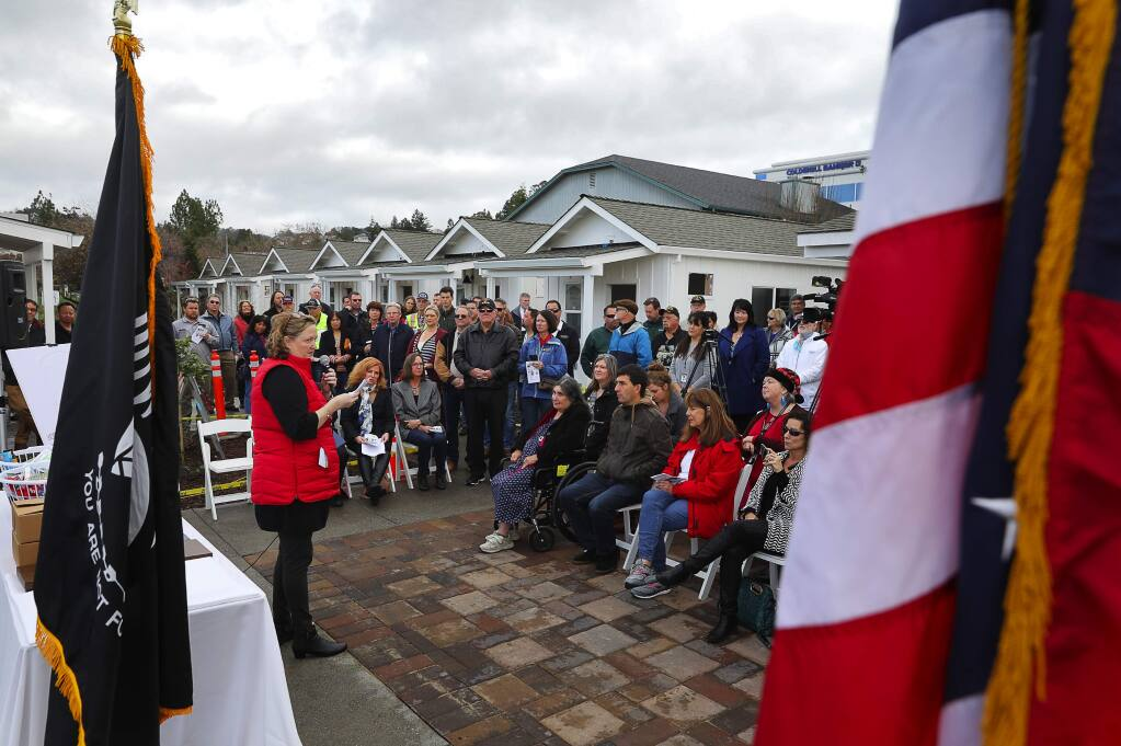 Paula Cook, executive director of Community Housing Sonoma County speaks during the John Zane-Michael Wolff Veterans Village dedication ceremony in Santa Rosa on Friday, Dec. 21, 2018. (CHRISTOPHER CHUNG/ PD)