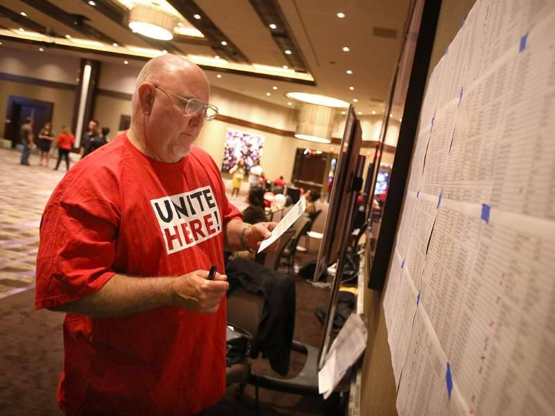 Union organizing committee member Rickey Baker marks off the names of employees who have filled out a union card at the Graton Resort & Casino in Rohnert Park on Tuesday, June 17, 2014. (CHRISTOPHER CHUNG/ PD FILE)