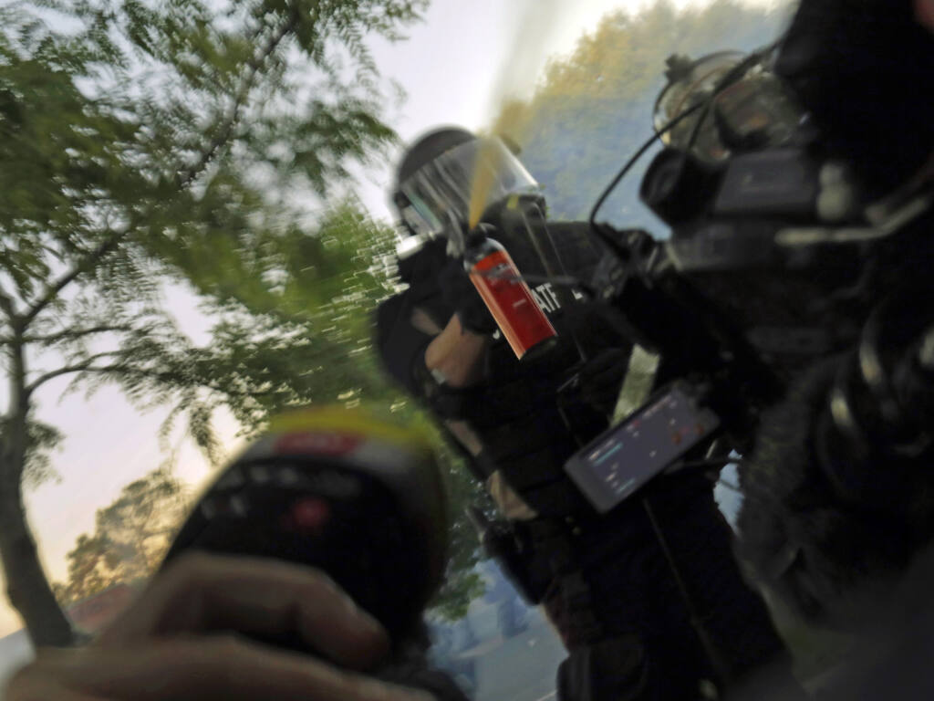 Minnesota State Patrol officers spray journalists with pepper spray and fire rubber bullets during a demonstration in June. (CAROLYN COLE / Los Angeles Times)