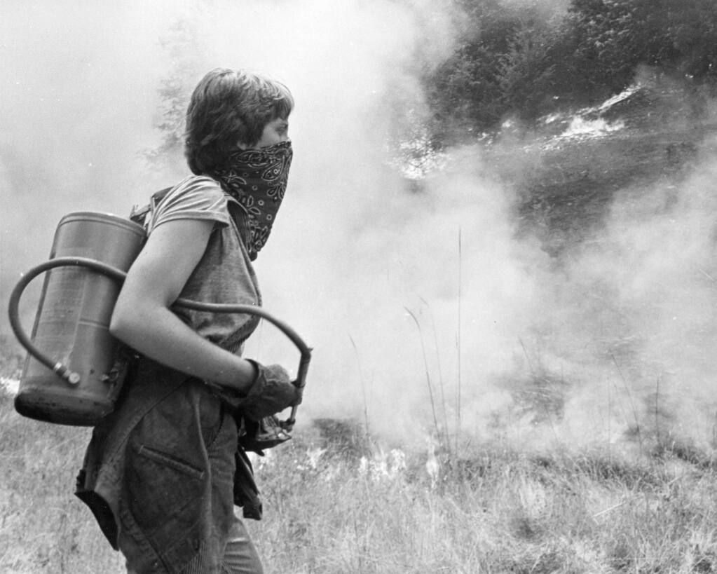 A woman covers her face with a bandana while helping to combat the Creighton Ridgefire in 1978. (Joe Price Jr. / The Press Democrat)