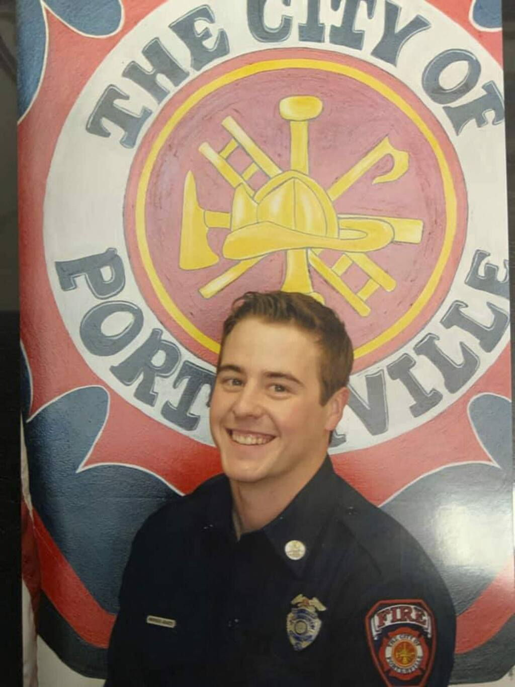 This undated photo provided by the Porterville, Calif., Fire Department show firefighter Patrick Jones. Two 13-year-old boys were arrested Tuesday, Feb. 18, 2020, for allegedly starting a blaze at the Porterville, Calif., Public Library that killed fire Capt. Raymond Figueroa, 35. Firefighter Jones, 25, is still missing, (Porterville Fire Department via AP)