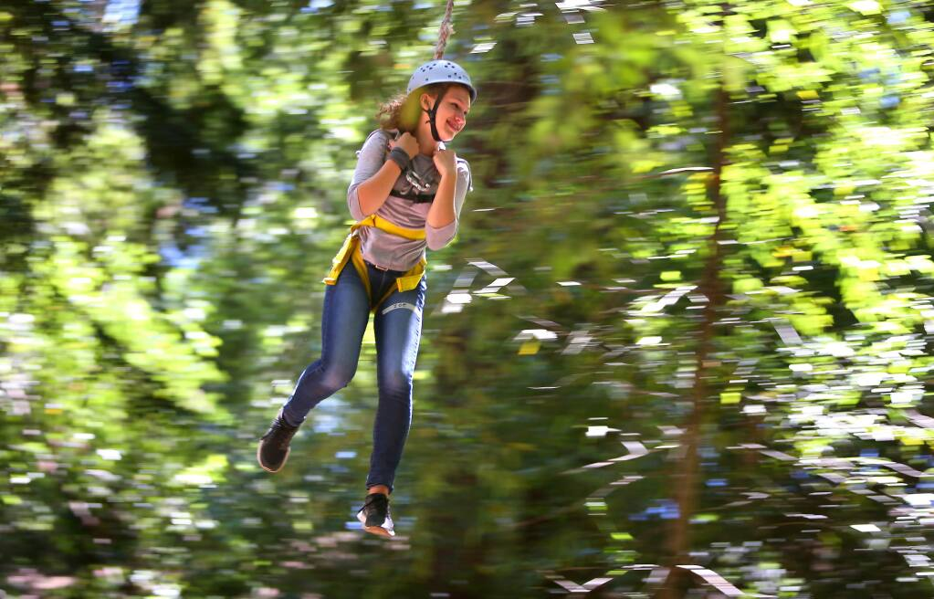 Christopher Chung/The Press Democrat file photoZoe Ingram, an intern with the Academy of Sciences' Careers in Science program, rides a zip line in 2014 at the ropes course on Sonoma Mountain.