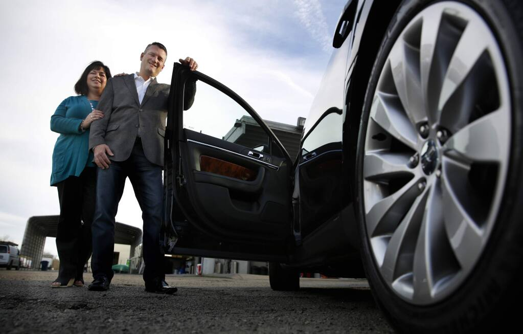 Gary and Jennifer Buffo are the owners of Pure Luxury Transportation in Petaluma, California on Wednesday, February 11, 2015. (BETH SCHLANKER/ The Press Democrat)