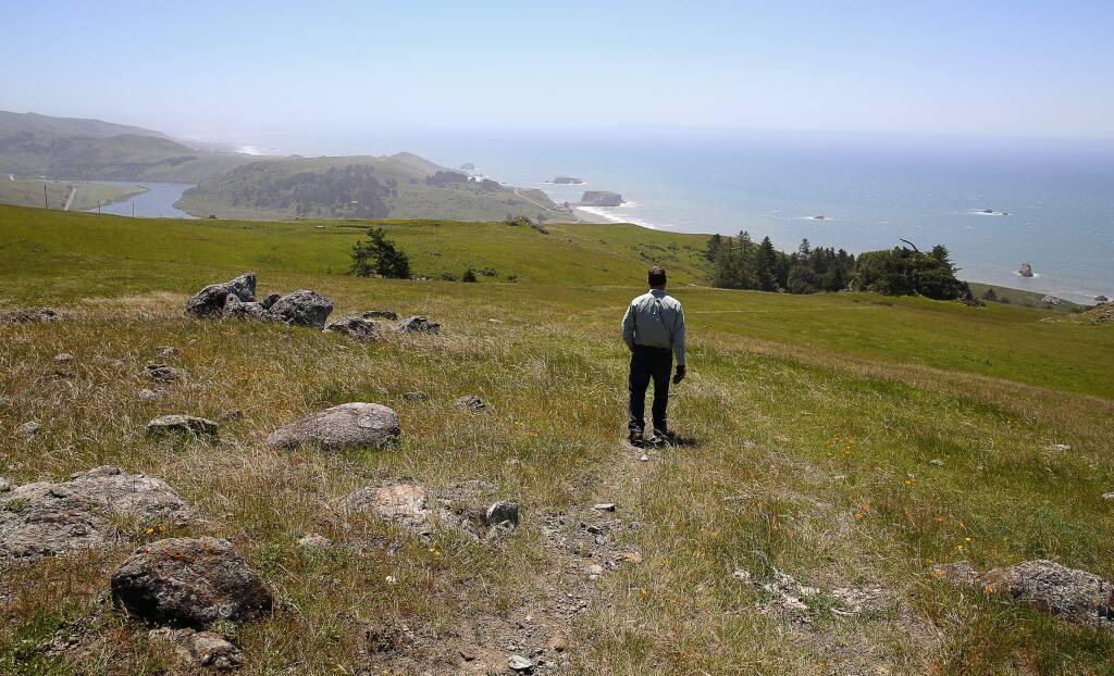 Jenner Headlands Preserve manager Brook Edwards, walks along a trail overlooking the coast, above Jenner, on Thursday, April 28, 2016. (Christopher Chung/ The Press Democrat)