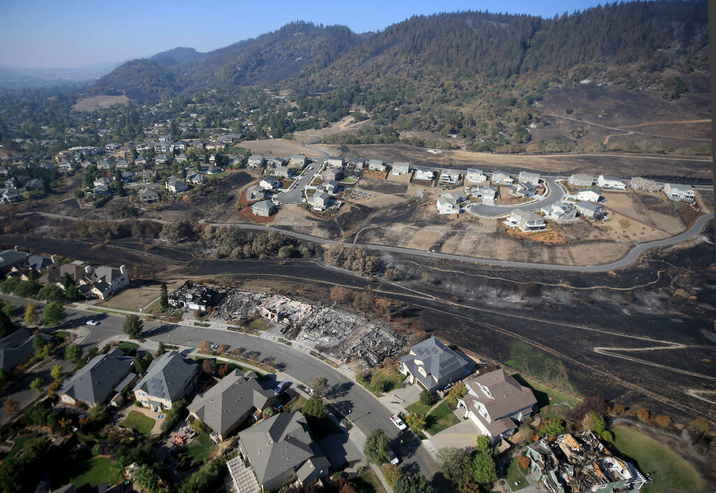 Firefighters made a stand on Night Hawk Drive, bottom,  losing a number of homes, but also saving hundreds to the west as embers landed in vegetation surrounding the houses. At top, Sunhawk Drive was also heavily defended as the Glass charted a path of destruction to the west and north. (Kent Porter / The Press Democrat) 2020