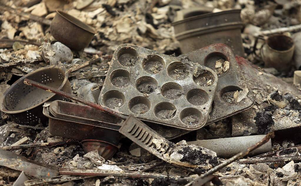 Cooking utensils from a burnt home in Hidden Valley Lake off Stonegate street, Sunday Sept. 13, 2015. (Kent Porter / Press Democrat) 2015