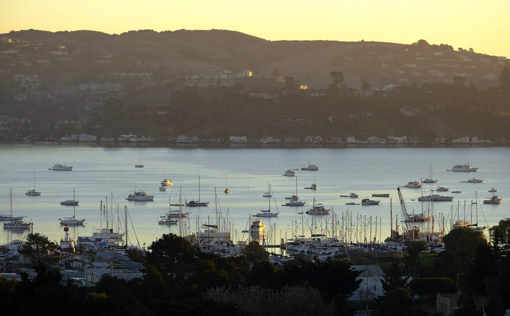 Numerous boats are anchored in Richardson Bay, Monday, Nov. 5, 2018, in Sausalito, Calif. Authorities are cracking down on small boats squatting off Sausalito, where the number of vessels that sit motionless away from shore has doubled over the last year amid a housing crisis in the San Francisco Bay Area. (AP Photo/Eric Risberg)