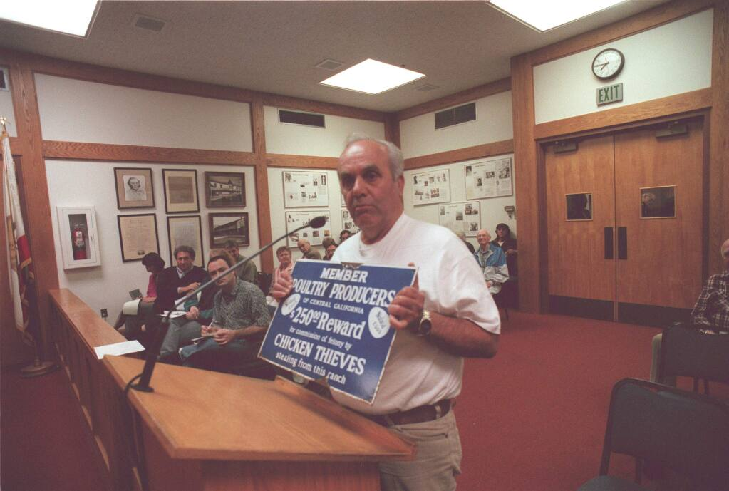 Jerry Marino addresses the Sonoma City Council on the subject of chickens in the Plaza, in 1999; he holds a sign that he said would help keep the chickens safe, and raise revenue for the city. (Press Democrat file)