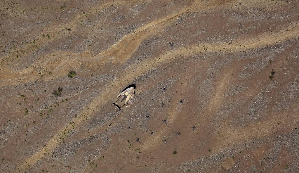 Signs of California's drought: Receding water on Lake Mendocino exposes a sunken boat (KENT PORTER / The Press Democrat)