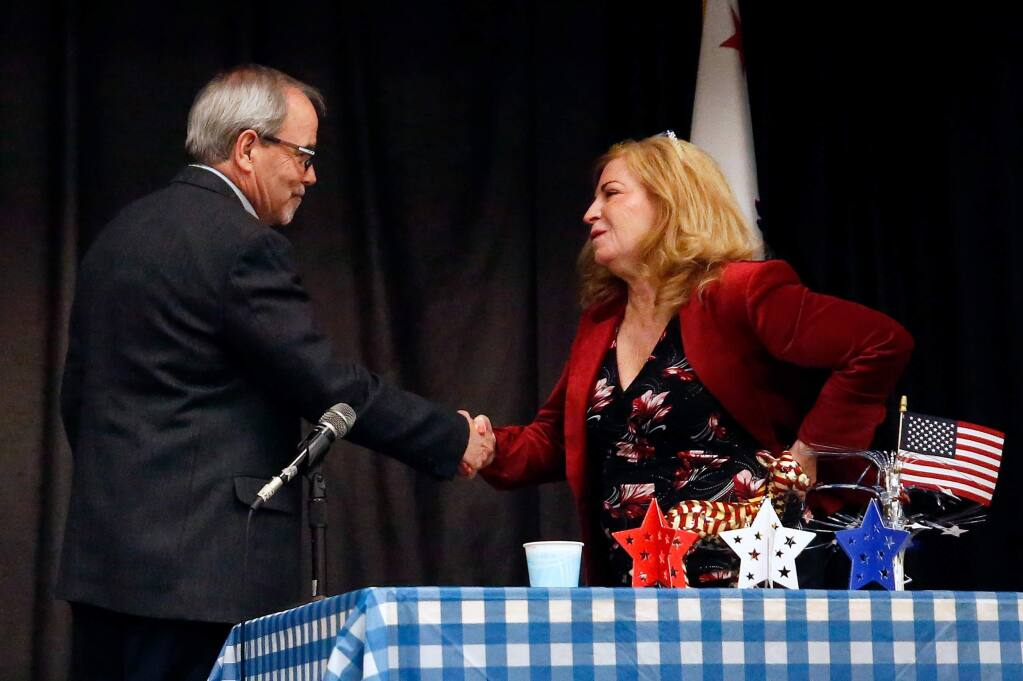 The candidates for Sonoma County District 3 supervisor, incumbent Shirlee Zane, right, and challenger Chris Coursey, shake hands before the start of their debate at Veterans Memorial Hall in Santa Rosa, California, on Wednesday, January 22, 2020. (Alvin Jornada / The Press Democrat)