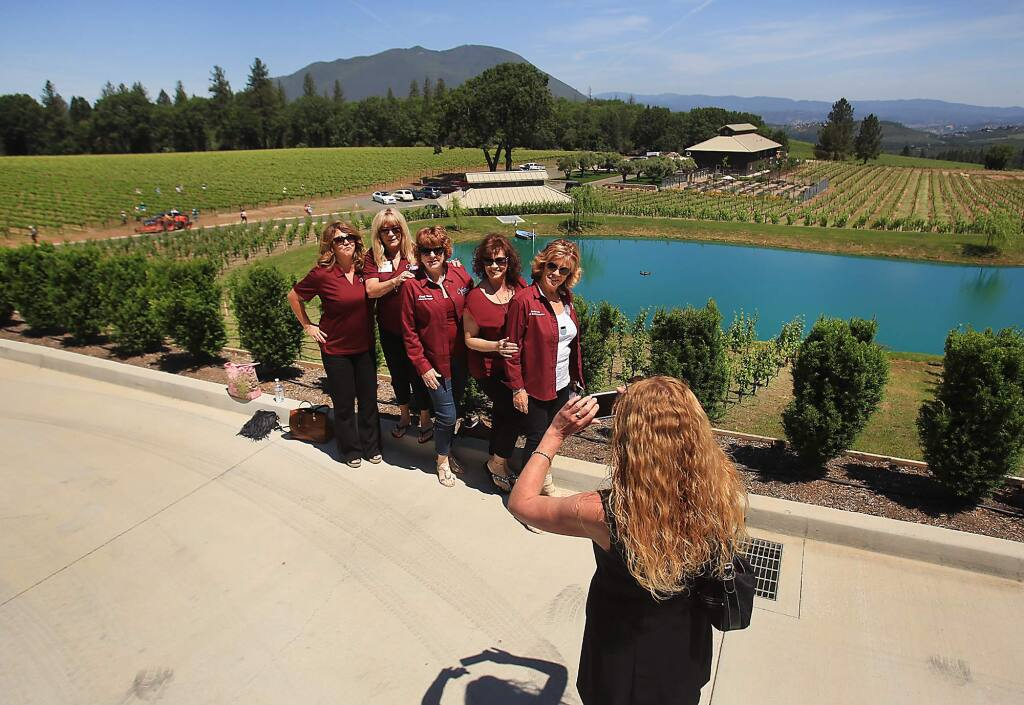 At the Northern and Central California Chamber Ambassador Rally at Boatique Winery in Kelseyville, Denise Rockenstein of Clear Lake Chamber of Commerce photographs, from left, Nicole Arabia, Judi Navarro, Cheryl Bovee, Jaye Lovelace and Denise Smith. Mt. Konocti is in the background Friday May 13, 2016. (Kent Porter / Press Democrat) 2016