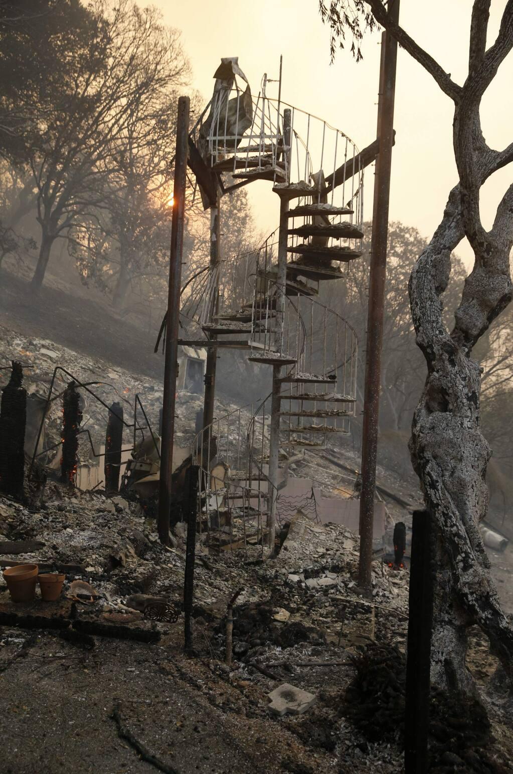 A staircase left among burned debris at the Olea Hotel on Monday, October 9, 2017 in Glen Ellen, California . (BETH SCHLANKER/The Press Democrat)