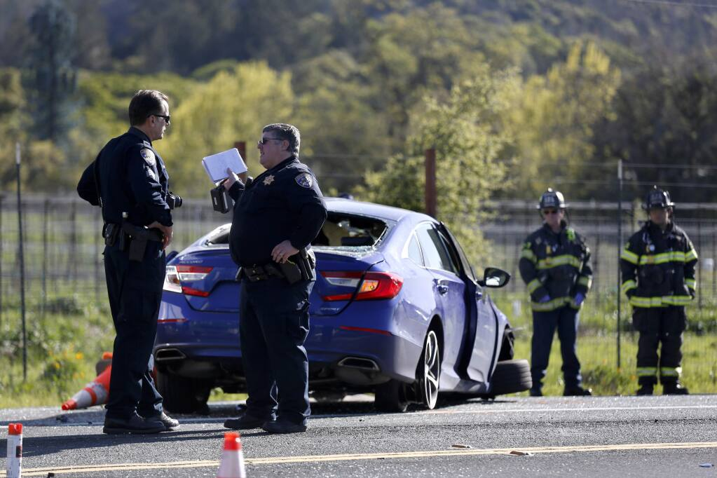 CHP and Santa Rosa firefighters work at the scene of a fatal accident involving a tree-trimming truck and a blue Honda Civic at the intersection of Hwy 12 and Oakmont Drive in Santa Rosa on Thursday, April 2, 2020. (BETH SCHLANKER/ The Press Democrat)