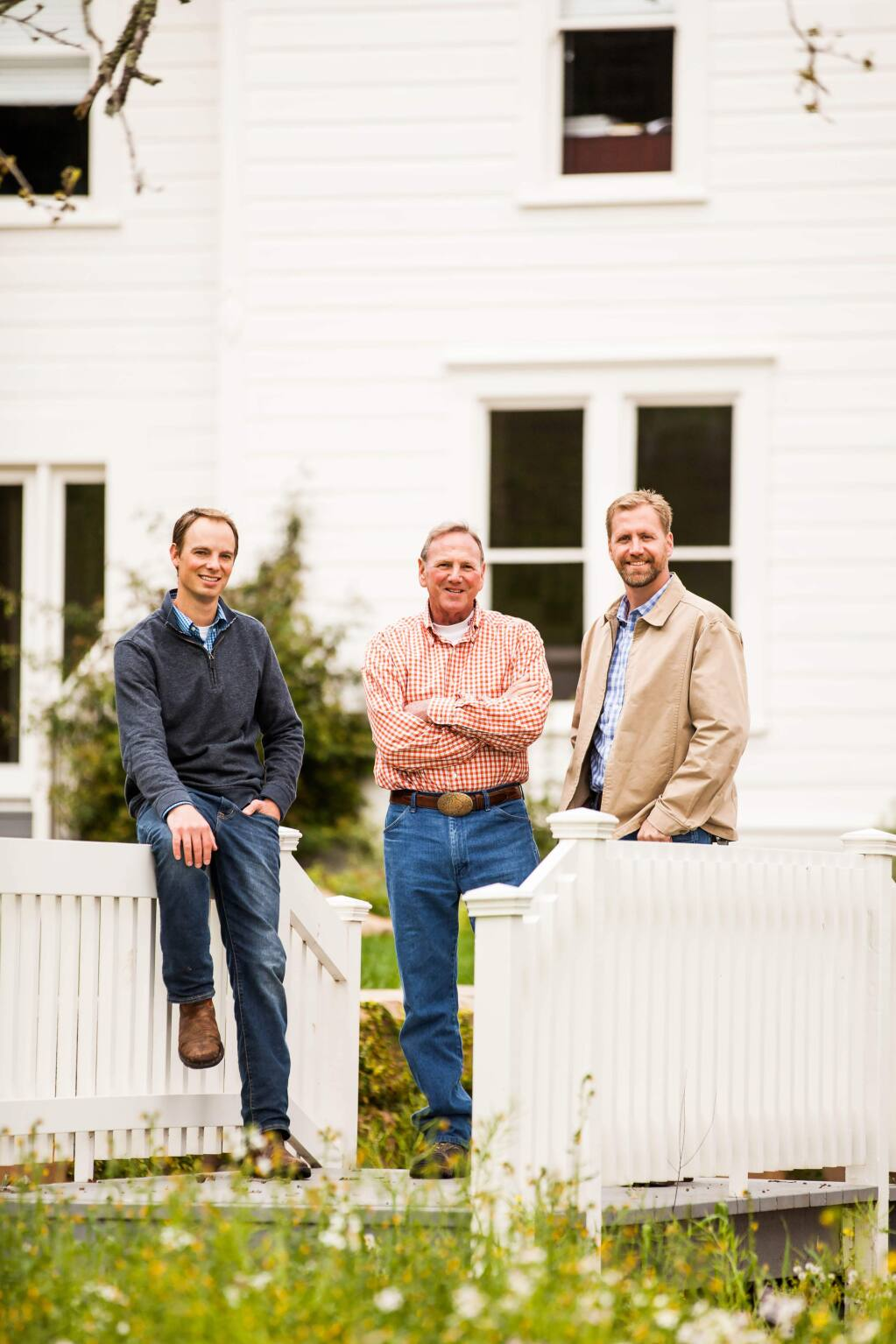 Bettinelli Vineyards is operated by Paul Goldberg, father-in-law Larry Bettinelli and brother-in-law Giancarlo Bettinelli. They stand in front of the vineyard estate home off Highway 29 in the Oak Knoll area of Napa Valley on March 6, 2016. (Brie Buhman Photography)