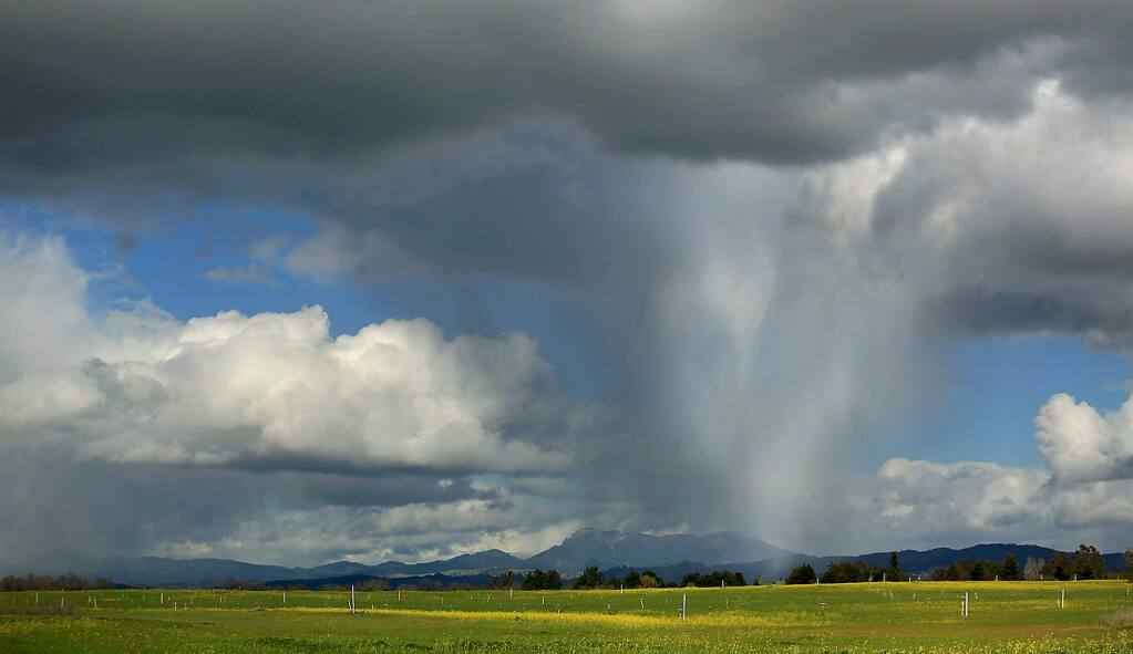 A hailstorm rolls over the Santa Rosa Plain with Mount St. Helena in the background in 2013. (KENT PORTER/ PD FILE)