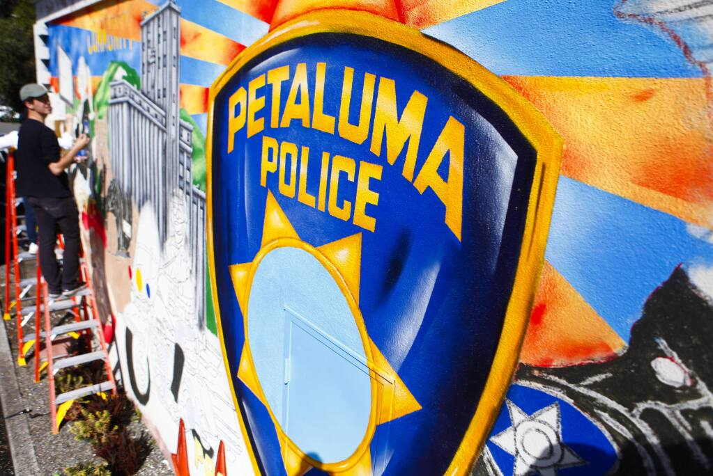 Petaluma, CA, USA. Monday, February 27, 2017._ Local artist, Maxfield Bala paints a mural at the Petaluma Police Department. (CRISSY PASCUAL/ARGUS-COURIER STAFF)