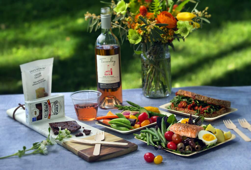 Celebrate Bastille Day with a Salmon Salade Nicoise Salad, at lower right, made with  haricots verts, potatoes, hard-cooked eggs, tomato and olives on a bed of greens. (John Burgess/Press Democrat)