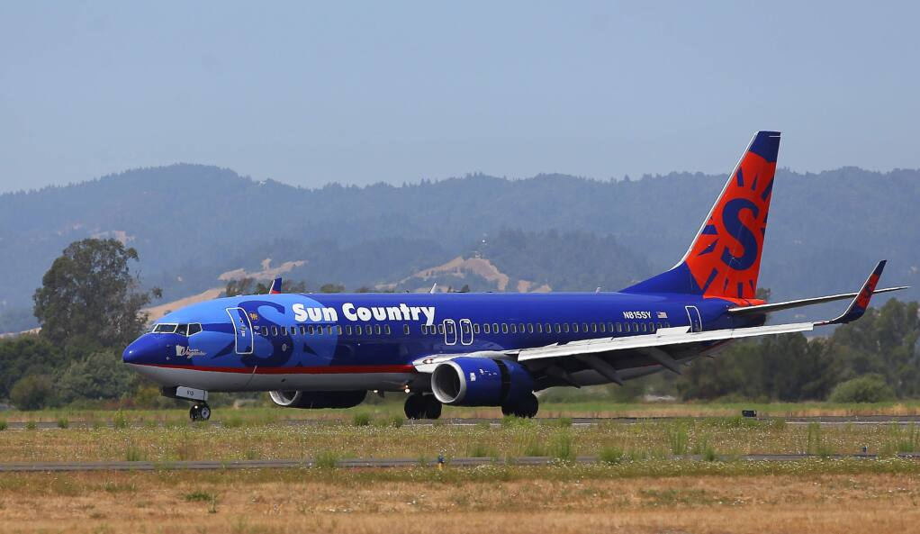 The first Sun Country Airlines flight from Minneapolis arrives at the Charles M. Schulz-Sonoma County Airport in Santa Rosa on Thursday, Aug. 24, 2017. (Christopher Chung/ The Press Democrat)