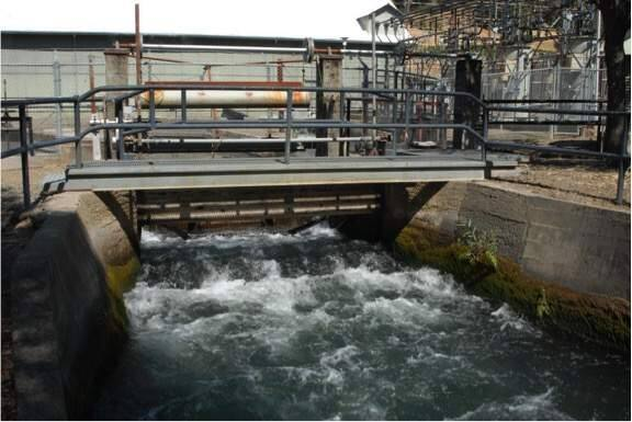 Water drawn from the Eel River spills from a tailrace behind PG&E's Potter Valley Powerhouse and becomes the start of the East Fork of the Russian River. (PG&E)