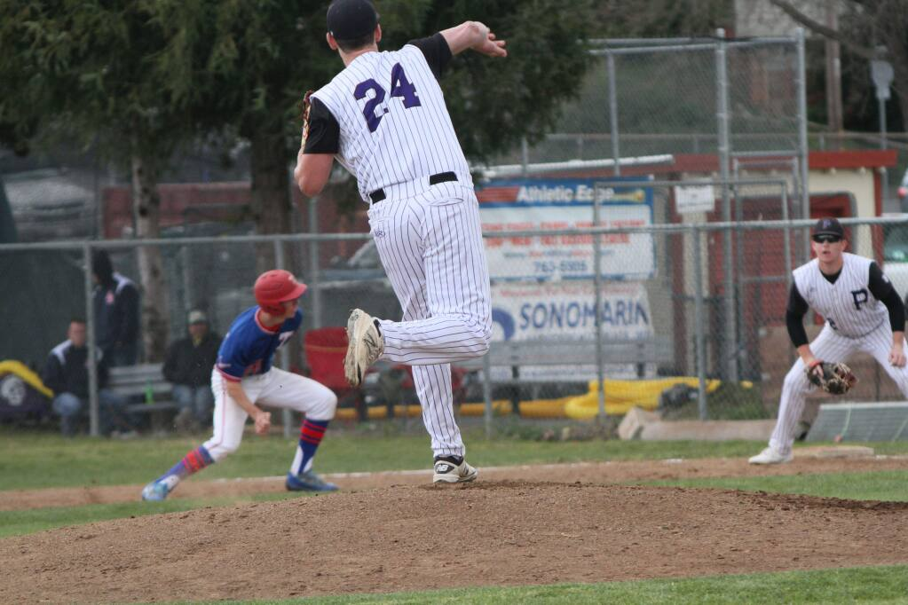 DWIGHT SUGIOKA/FOR THE ARGUS-COURIERPetaluma High pitcher Nick Siembieda throws to first baseman Sam Brown in an attempt to pick off Tamalpais base runner. Petaluma defeated Tam, 4-3.