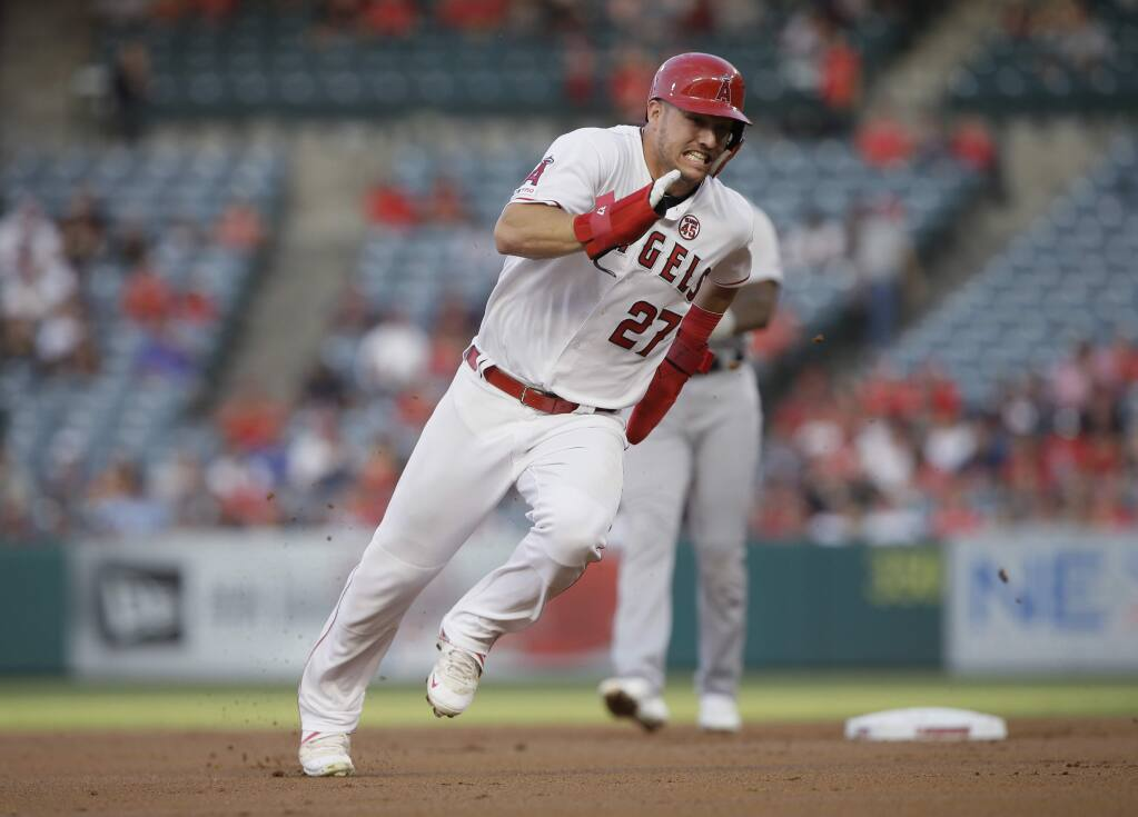 In this July 30, 2019, file photo, the Los Angeles Angels' Mike Trout rounds second to advance to third from first on a single by Shohei Ohtani against the Detroit Tigers during the first inning in Anaheim. (AP Photo/Alex Gallardo, File)