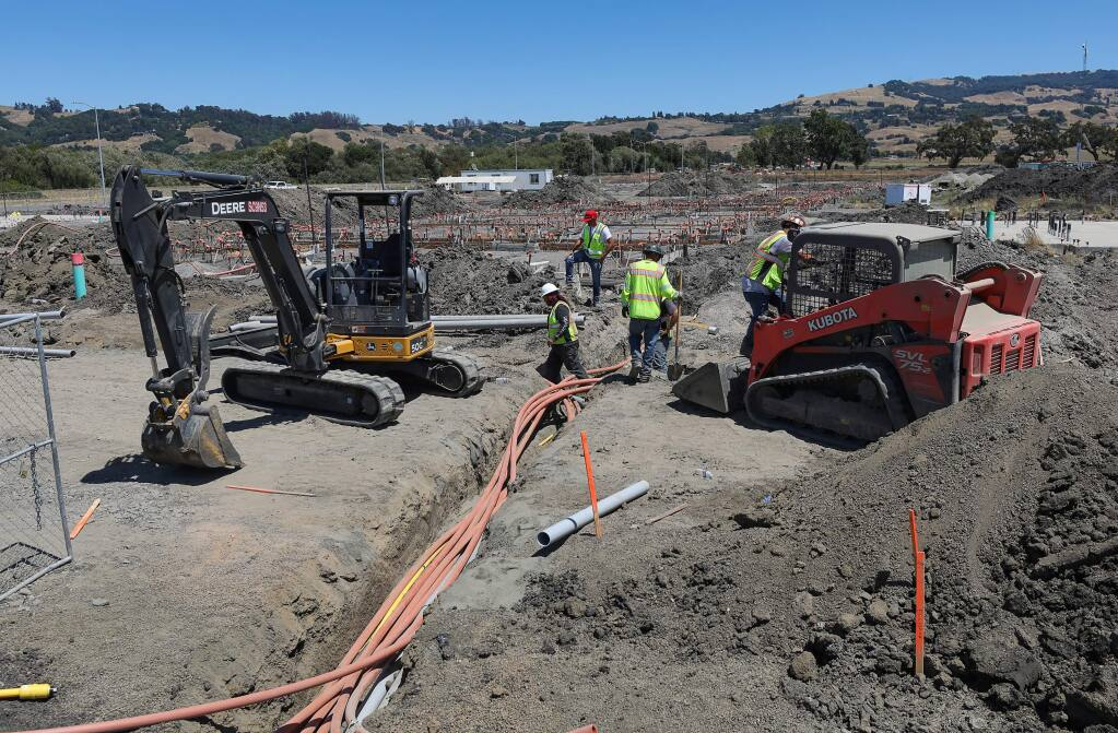 A construction crew continues work on The Parkside apartment project, which will provide affordable housing, in Rohnert Park on Friday, August 2, 2019. (Christopher Chung/ The Press Democrat)