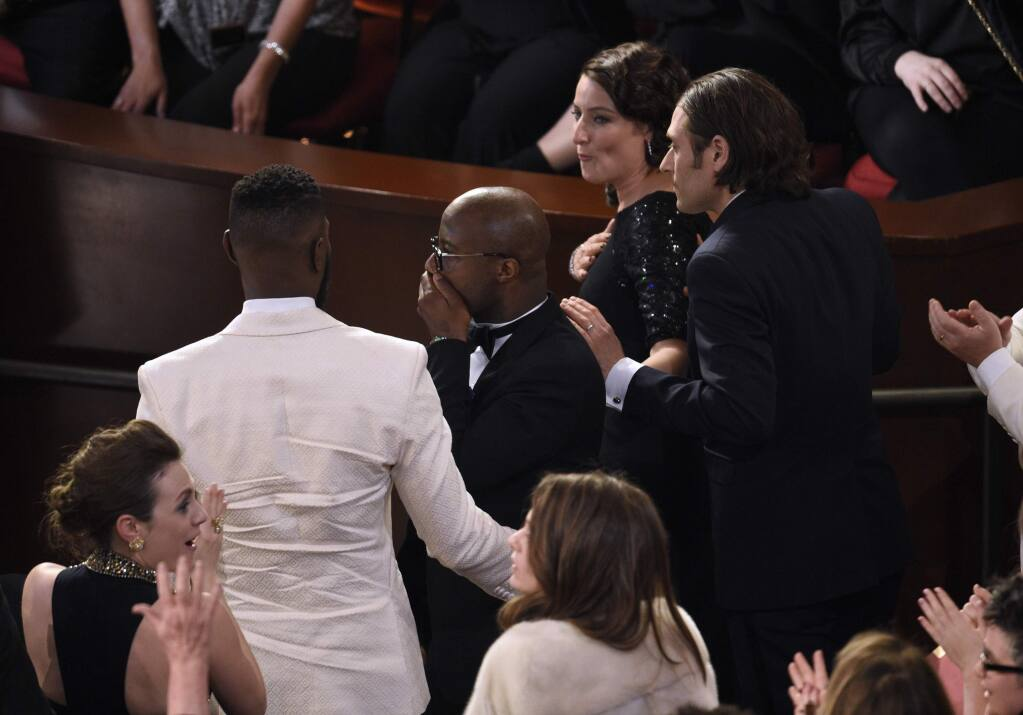 Barry Jenkins reacts as 'Moonlight' is announced as the true winner of best picture at the Oscars on Sunday, Feb. 26, 2017, at the Dolby Theatre in Los Angeles. It was originally announced mistakenly that 'La La Land' was the winner. (Photo by Chris Pizzello/Invision/AP)