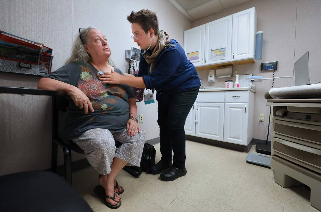Family nurse practitioner Jennifer Herman, right, examines Pathena Byerley at the Russian River Health Center in Guerneville on Thursday, August 22, 2019. (Christopher Chung/ The Press Democrat)