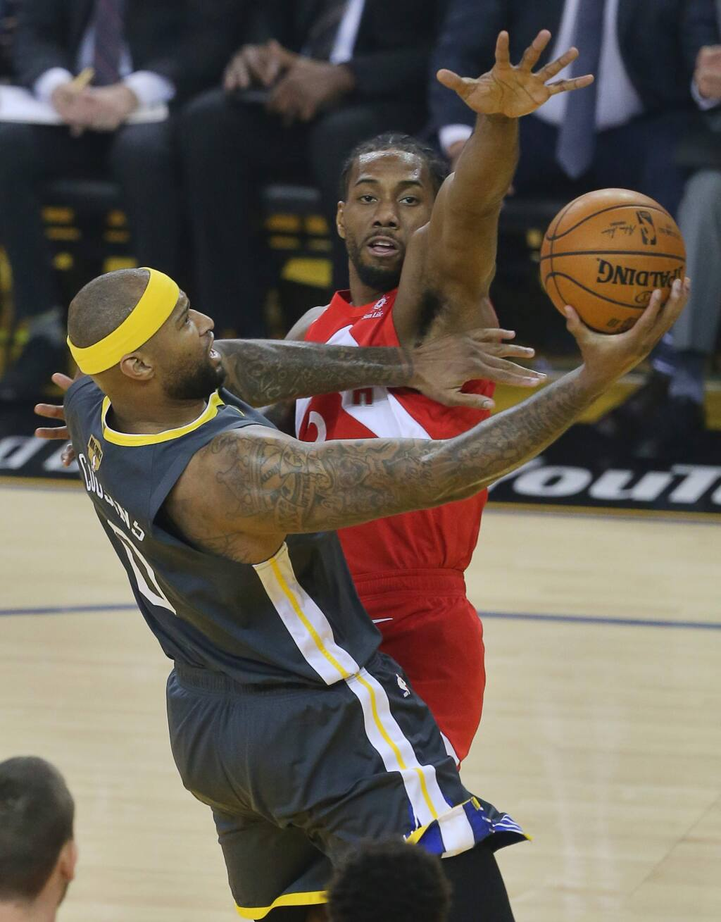 Golden State Warriors center DeMarcus Cousins lays the ball up against Toronto Raptors forward Kawhi Leonard during game 4 of the NBA Finals in Oakland on Friday, June 7, 2019. (Christopher Chung/ The Press Democrat)