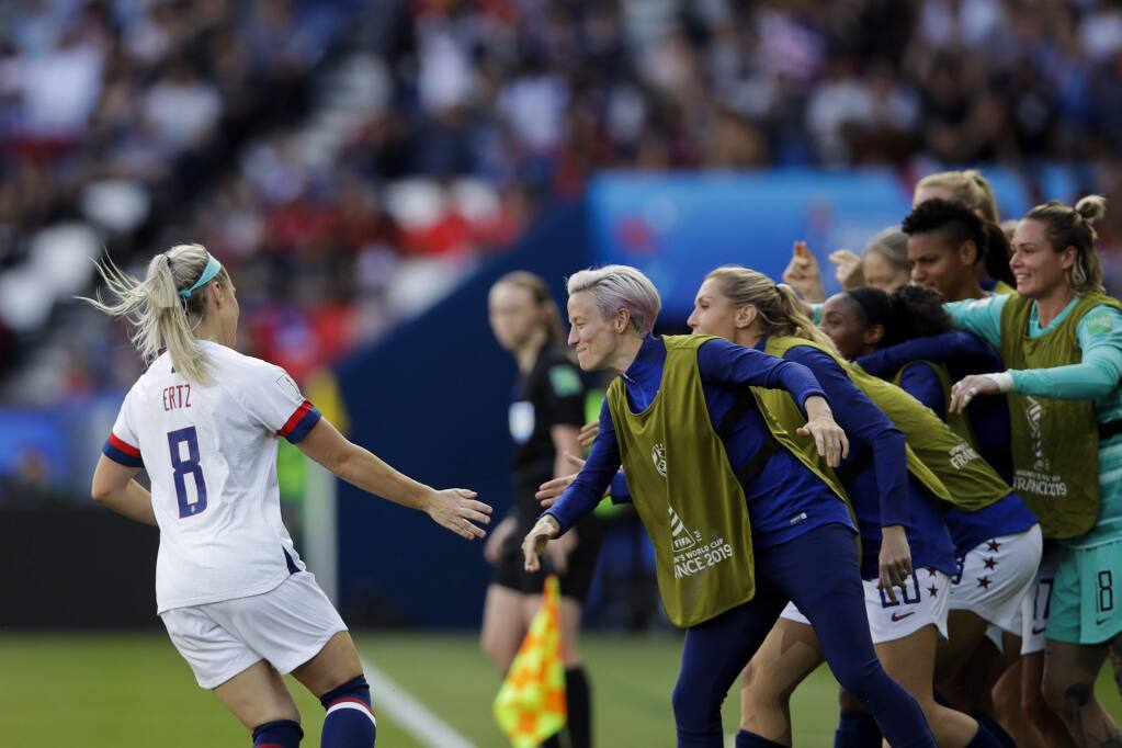 United States' Julie Ertz, left, celebrates with teammates after scoring their second goal during the Women's World Cup Group F soccer match between United States and Chile at Parc des Princes in Paris, France, Sunday, June 16, 2019. (AP Photo/Alessandra Tarantino)